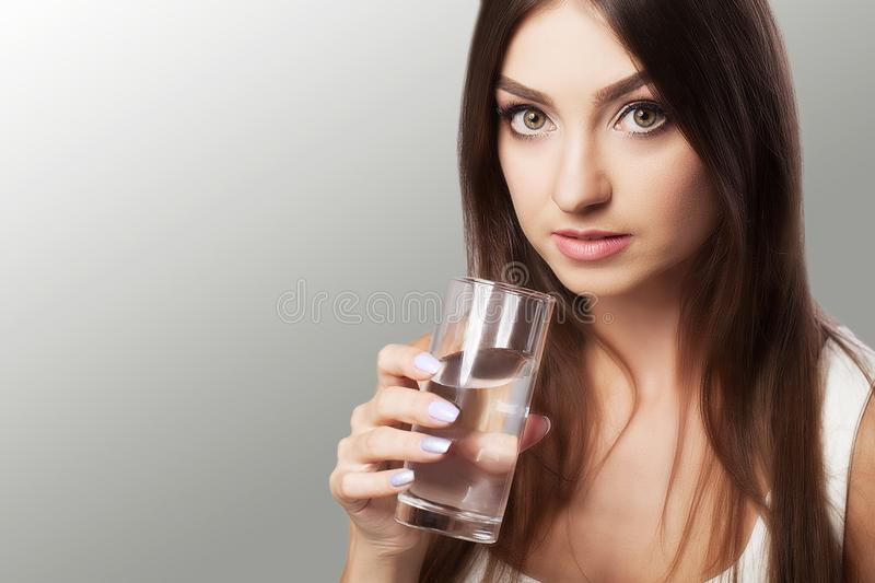 Healthy Lifestyle. Portrait Of Happy Smiling Young Woman With Glass Of Fresh Water. Healthcare Drinks Health, Beauty, Diet royalty free stock image
