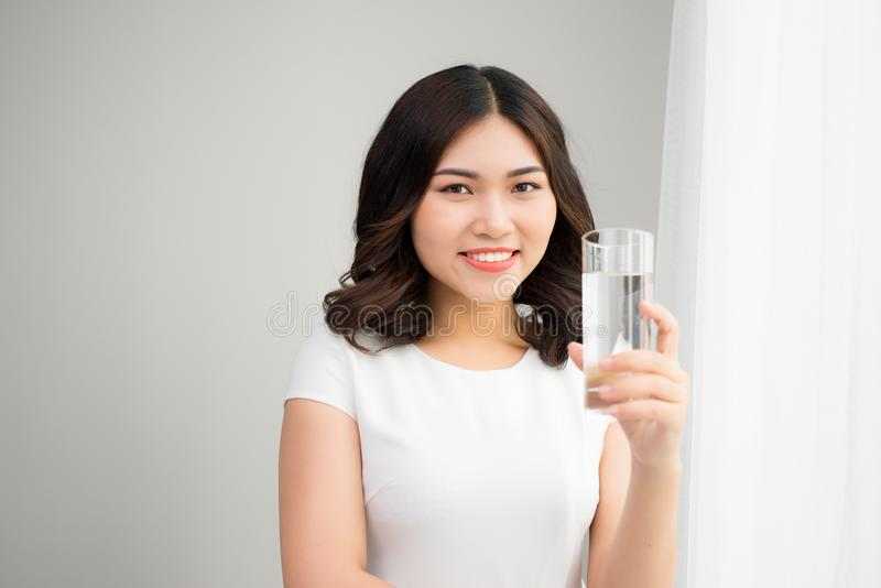 Healthy Lifestyle. Portrait Of Happy Smiling Young Woman With Glass Of Fresh Water. Healthcare. Drinks. Health, Beauty, Diet stock photos