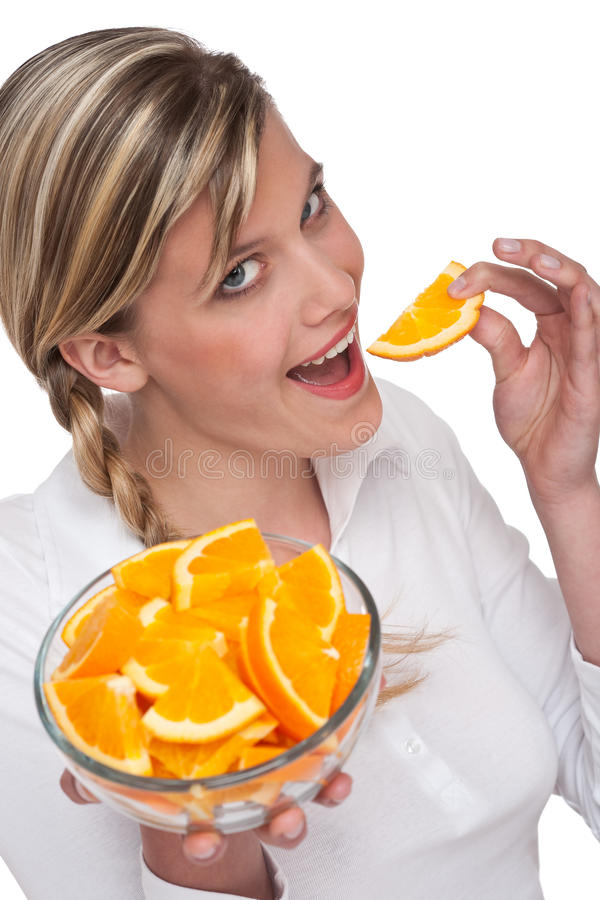 Healthy lifestyle series - Woman eating orange