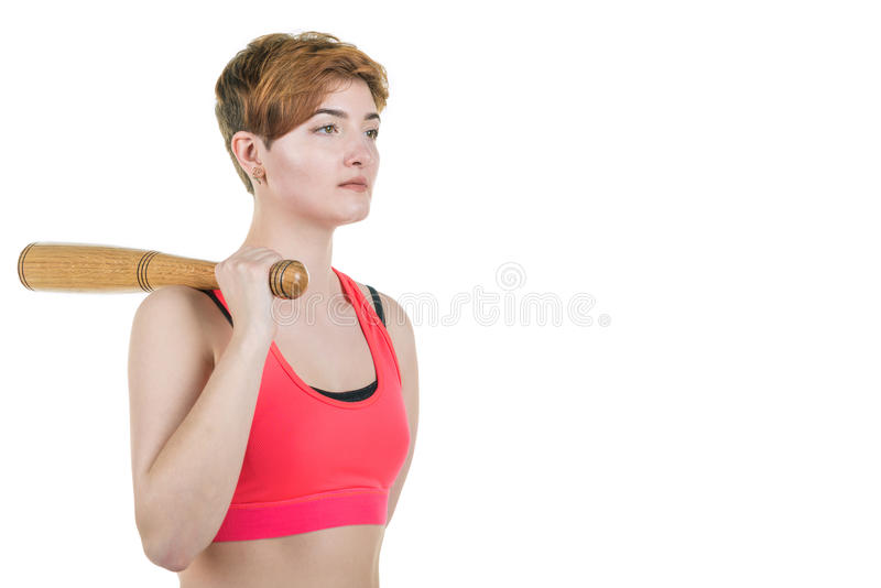 Healthy lifestyle, sport. A young girl is holding a baseball bat, on a white background. Horizontal frame royalty free stock photos