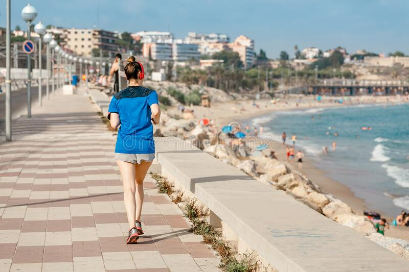 Lifestyle sports person running along seaside. Healthy lifestyle sports person running along seaside stock images