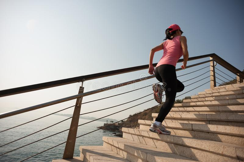 Woman running on seaside promenade stock photos