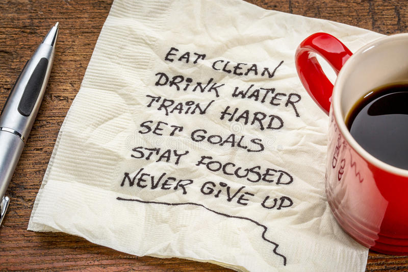 Healthy lifestyle tips on napkin. Healthy lifestyle tips - handwriting on a napkin with a cup of coffee royalty free stock images