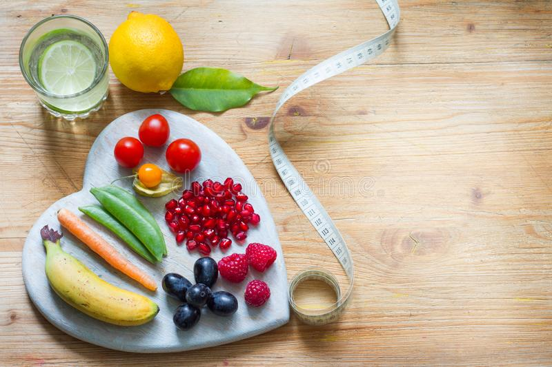 Healthy lifestyle vegetarian food in heart and stethoscope with water alternative medicine background concept. Closeup stock photography