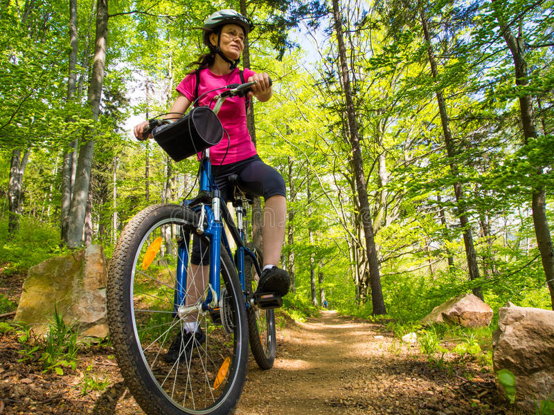 Healthy lifestyle - woman cycling stock photo