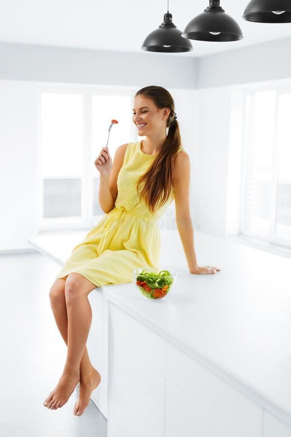 Healthy Lifestyle. Woman Eating Vegetarian Food. Dieting, Diet C. Healthy Lifestyle. Happy Smiling Caucasian Woman Eating Fresh Organic Green Vegetarian Food royalty free stock photos