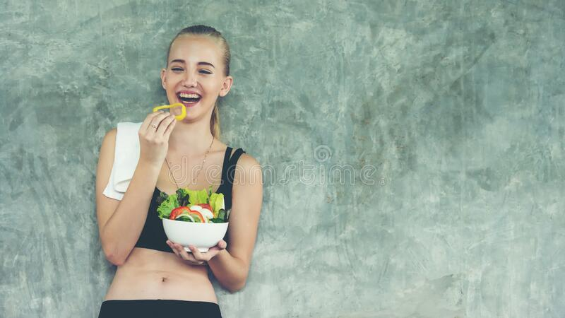 Healthy lifestyle woman fitness gym for body slim. Young people girl hold fresh salad after exercise. royalty free stock photos