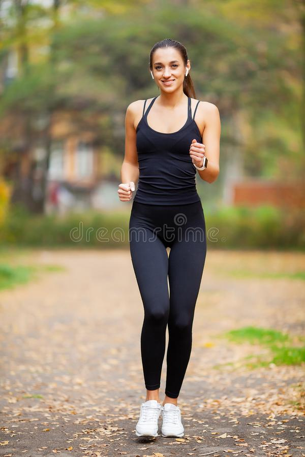 Healthy lifestyle. Woman jogging on forest trail royalty free stock images