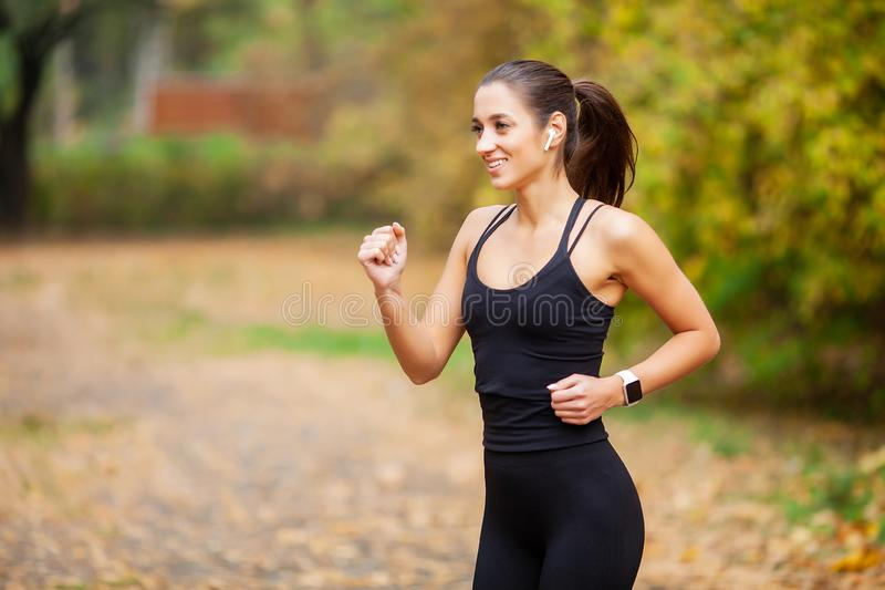Healthy lifestyle. Woman jogging on forest trail stock images