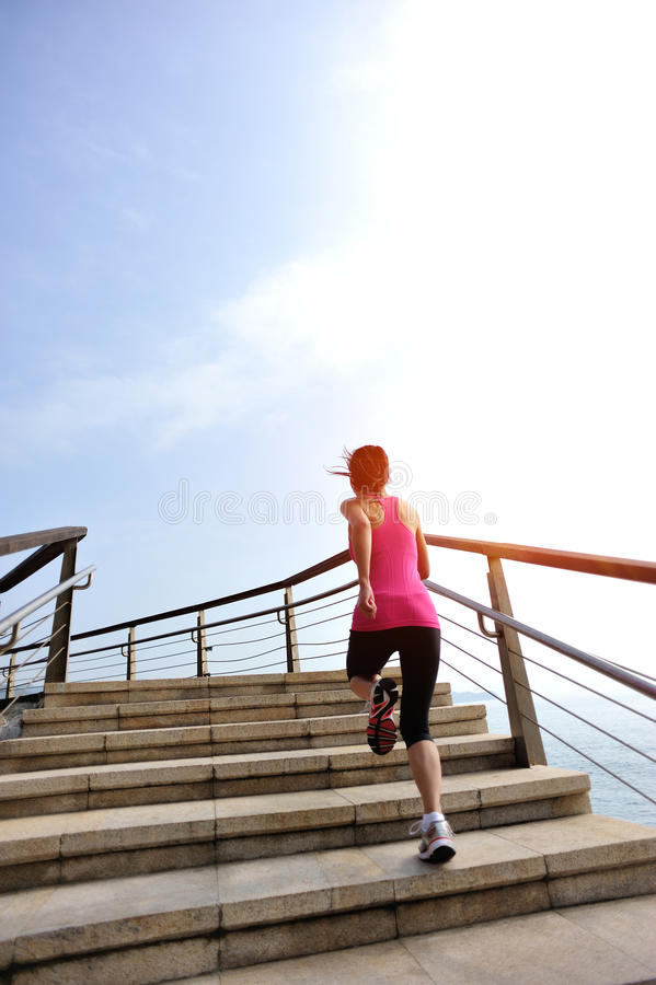 Healthy lifestyle woman legs running on stone stai. Healthy lifestyle sports woman legs running on stone stairs seaside royalty free stock photos