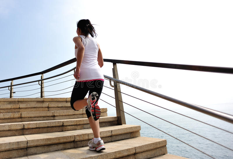 Healthy lifestyle woman legs running on stone stai. Healthy lifestyle sports woman legs running on stone stairs seaside stock photography