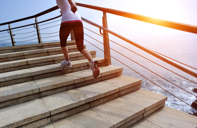 Healthy lifestyle woman legs running on stone stai. Healthy lifestyle sports woman legs running on stone stairs seaside royalty free stock photography