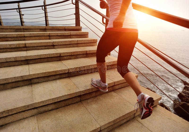 Healthy lifestyle woman legs running on stone stai. Healthy lifestyle sports woman legs running on stone stairs seaside stock photo