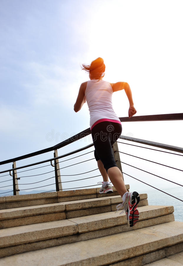Healthy lifestyle woman legs running on stone stai. Healthy lifestyle sports woman legs running on stone stairs seaside stock photos