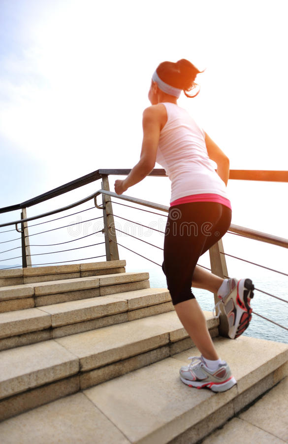 Healthy lifestyle woman legs running on stone stai. Healthy lifestyle sports woman legs running on stone stairs seaside stock images