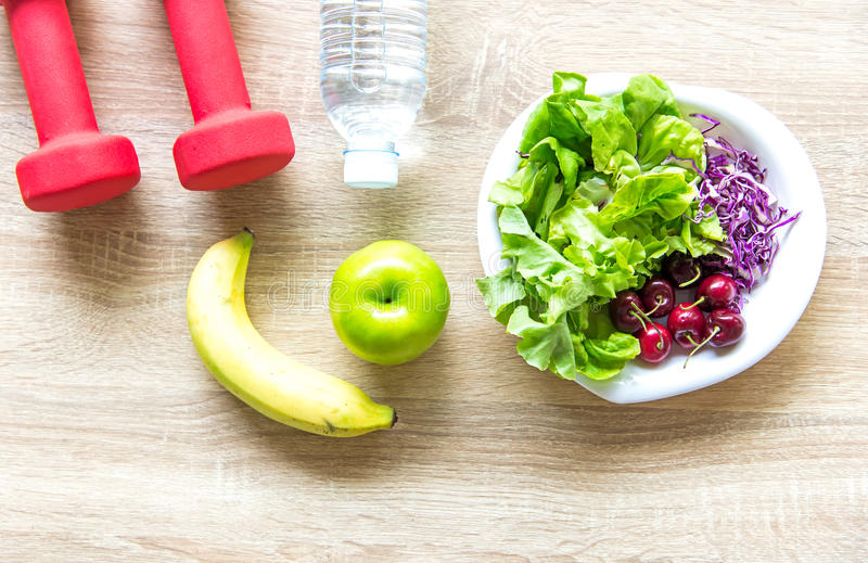 Healthy lifestyle for women diet with sport equipment, sneakers, measuring tape, fruit healthy green apples and bottle of water on. Wooden. Healthy Concept stock images