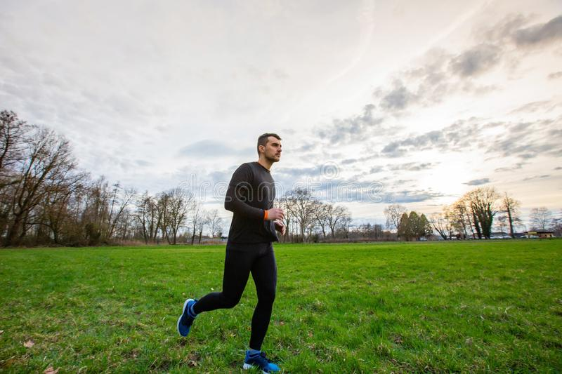 Healthy lifestyle. Young athletic man practicing sport outdoors city park. Self overcome conquering obstacles and win. Healthy lifestyle concept. Workout jogging royalty free stock images