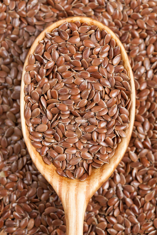 Healthy little brown flax seeds super foods in royalty free stock photo