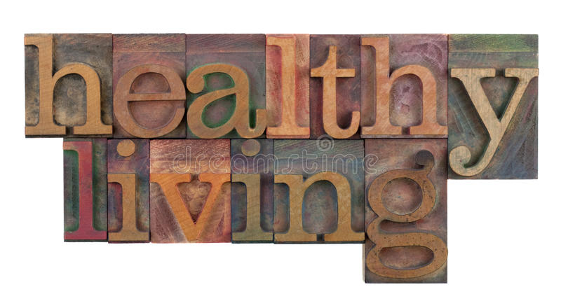 Healthy living. Title or headline in vintage wooden letterpress type blocks, stained by color ink, isolated on white stock photos