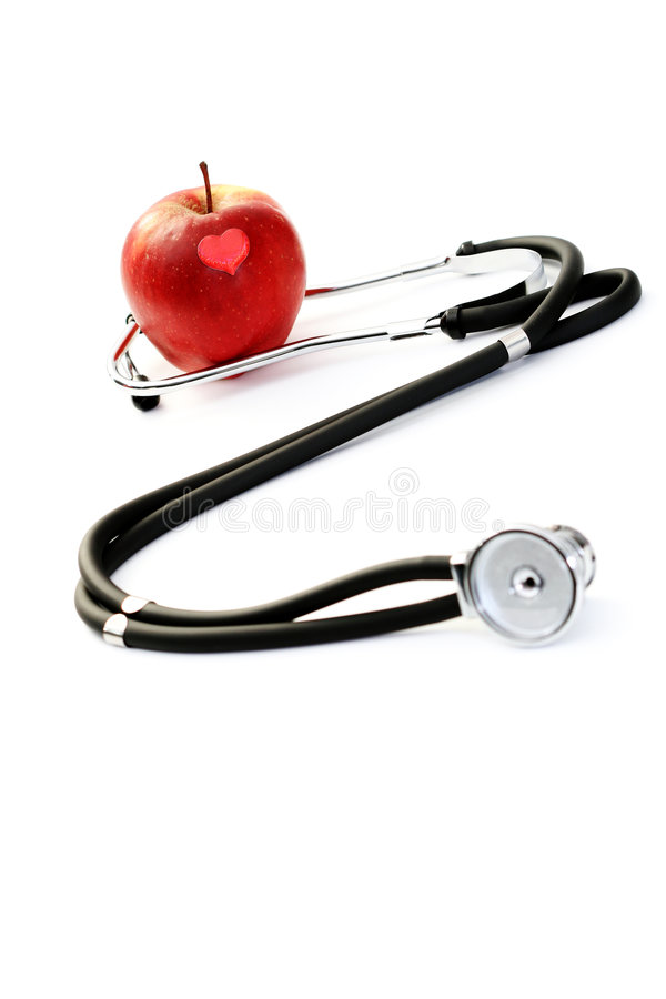 Healthy living. Stethoscope and red apple on white - healthy living stock photo