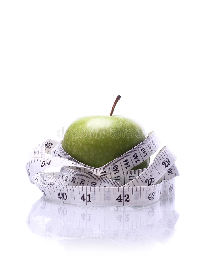 Download Healthy Living-Apple Being Measured Stock Photo - Image: 21425740