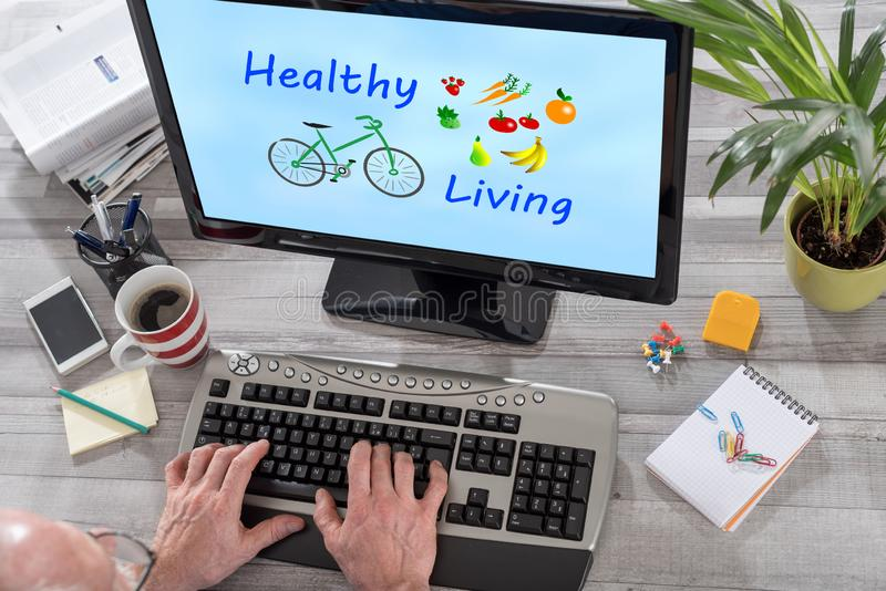 Healthy living concept on a computer. Man using a computer with healthy living concept on the screen royalty free stock photo