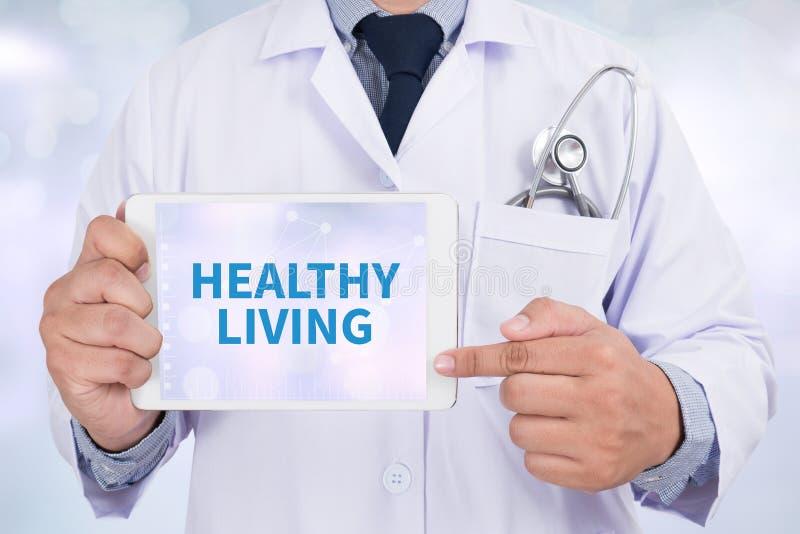 HEALTHY LIVING. Doctor holding digital tablet stock image