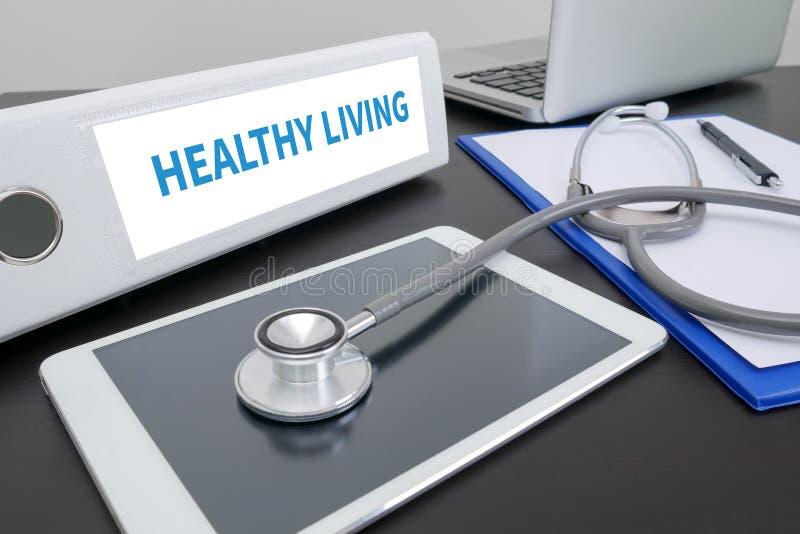 HEALTHY LIVING. Folder on Desktop on table. ipad royalty free stock photos