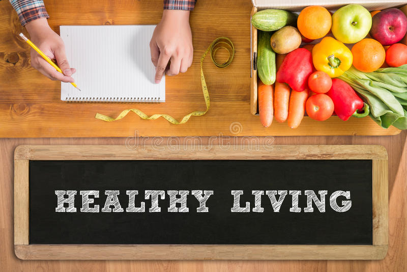 HEALTHY LIVING. Fresh vegetables and on a wooden table royalty free stock photo
