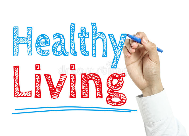 Healthy Living. Man is writing text Healthy Living with marker on transparent wipe board royalty free stock photo