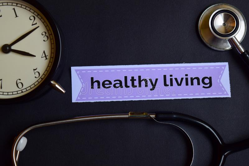 Health Strategy on the print paper with Healthcare Concept Inspiration. alarm clock, Black stethoscope.Healthy Living on the print. Healthy Living on the print stock image