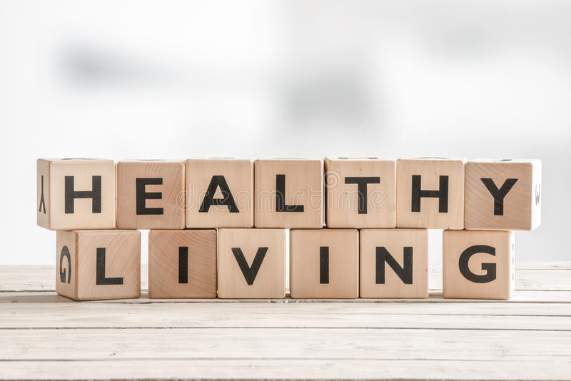 Healthy living sign with wooden cubes. On a table royalty free stock photo