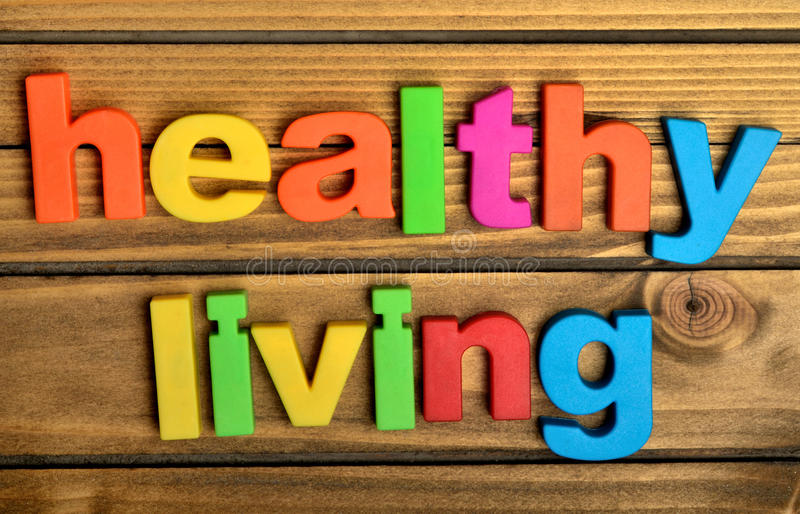Healthy living word. On wooden table stock photography