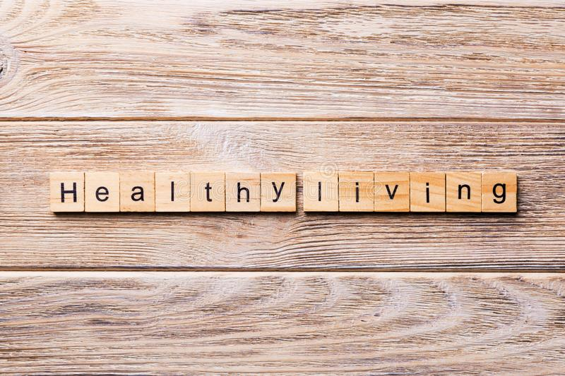 Healthy Living word written on wood block. Healthy Living text on wooden table for your desing, concept.  royalty free stock photo