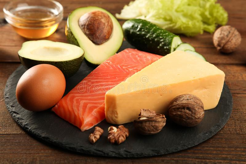 Healthy low carbs products. On slate blackboard on wooden background. Concept ketogenic diet, healthy food stock photo
