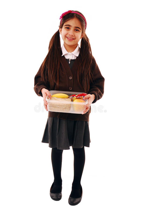 Healthy lunch. Schoolgirl holding her lunch box stock photos