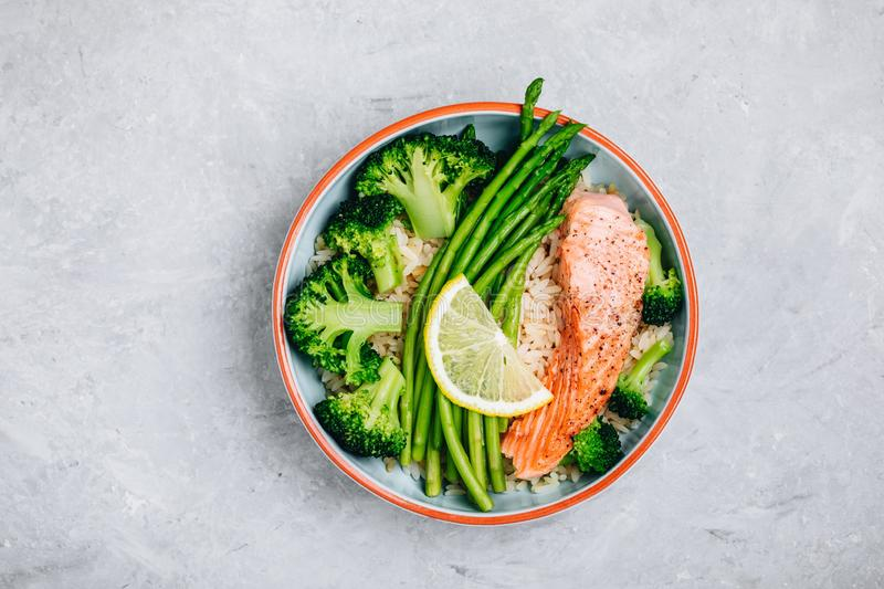 Healthy lunch bowl salmon and broccoli with asparagus and rice royalty free stock photography