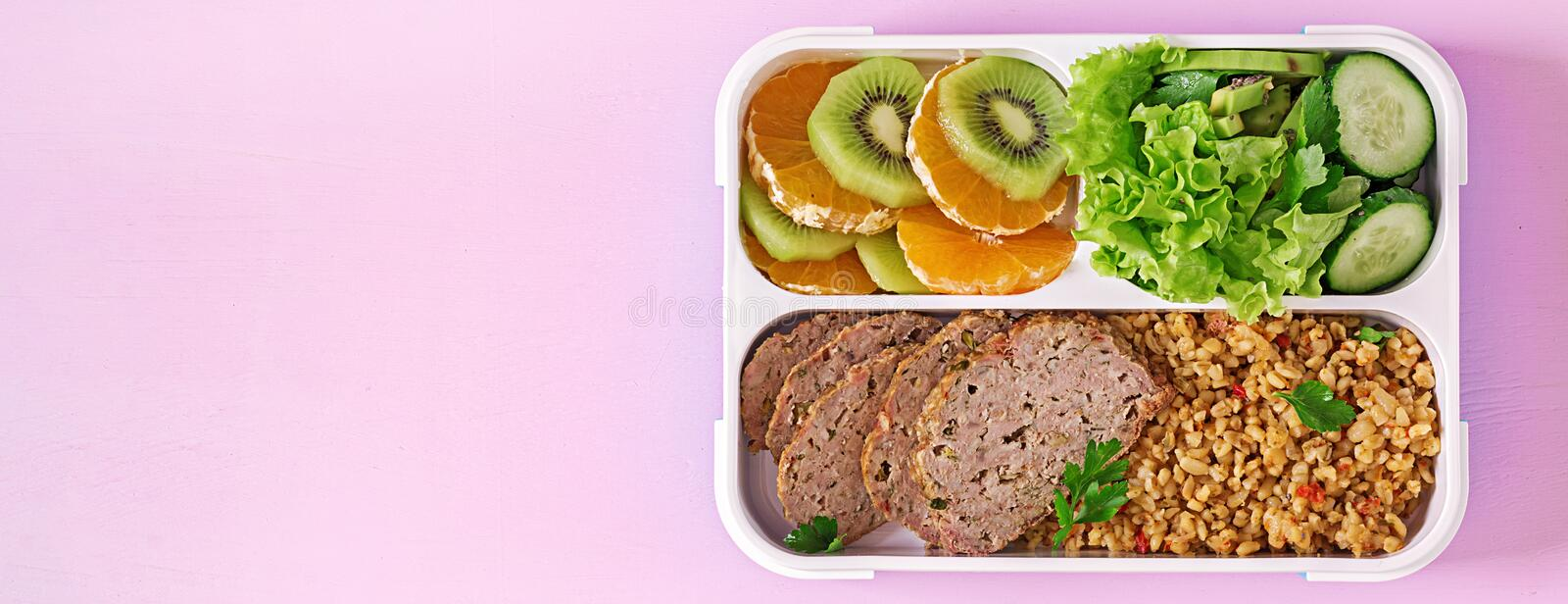 Healthy lunch with bulgur, meat and fresh vegetables and fruit stock photo