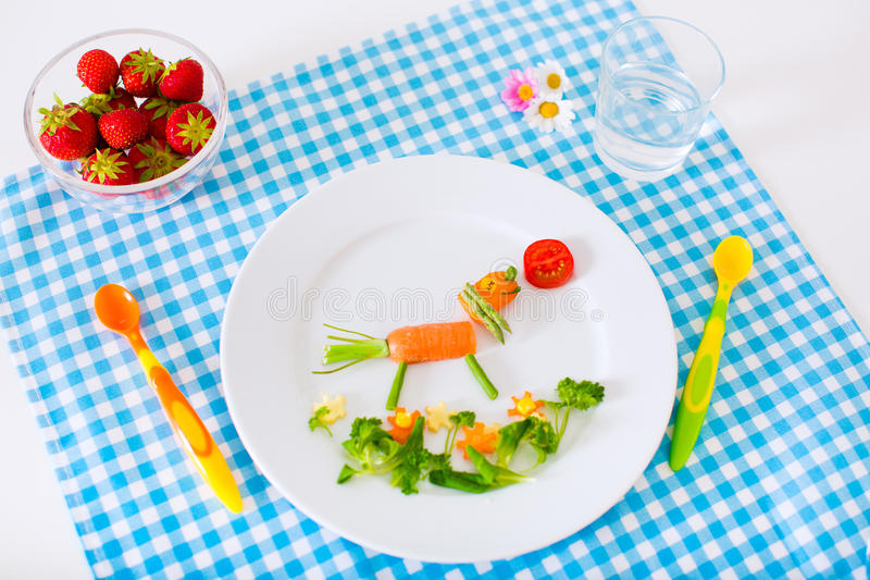 Healthy lunch for children. Healthy vegetarian lunch for little kids. Kid meal. Vegetable and fruit served as animals, corn, broccoli, carrot, strawberry helping stock images