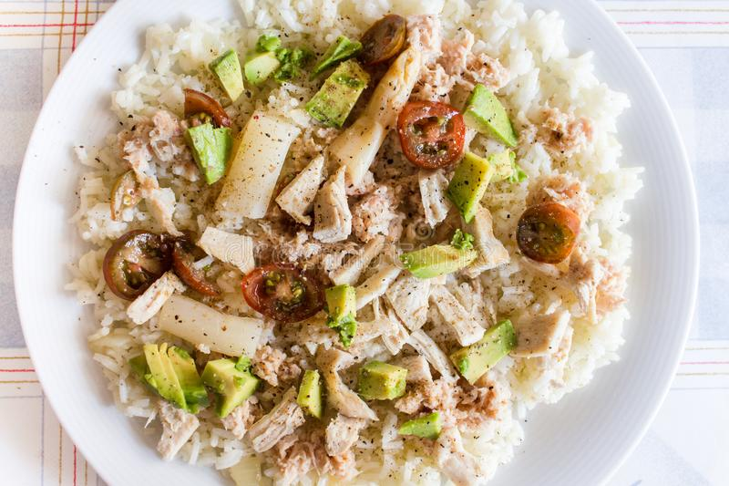 Healthy lunch for fitness people, with rice, tuna, cherry tomatoes, avocado, asparagus, chicken, seasoned with salt, pepper and stock images