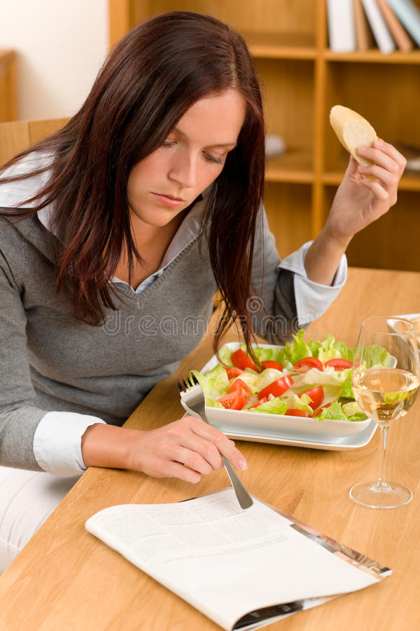 Healthy lunch at home woman read magazine stock photography