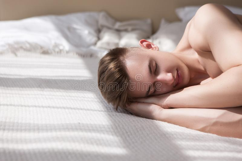 Healthy man comfort bed relax concept stock image