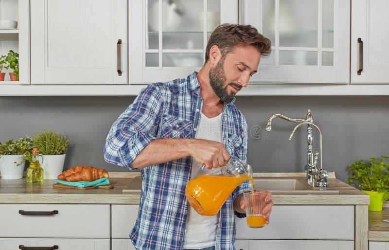 Healthy man drinking orange juice stock images