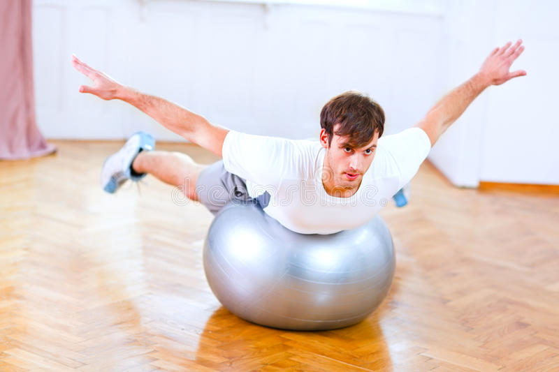 Download Healthy Man Making Exercises On Fitness Ball Royalty Free Stock Photo - Image: 22239105