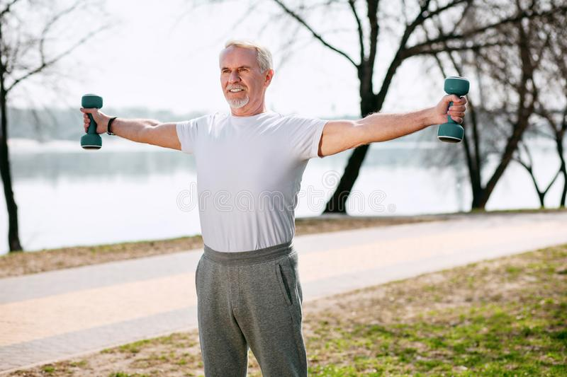 Healthy mature man improving body shape royalty free stock images