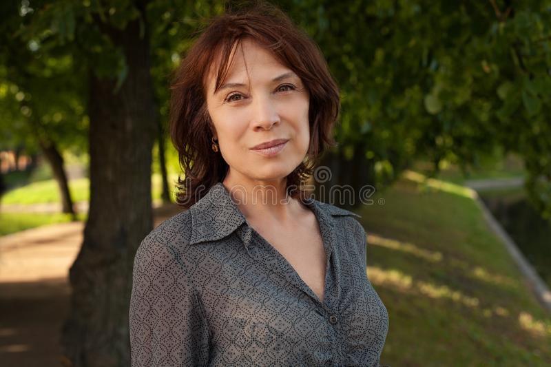 Healthy mature woman face, outdoors royalty free stock photos