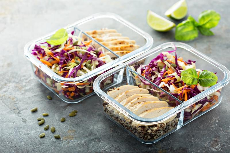Healthy meal prep containers with quinoa and chicken royalty free stock image