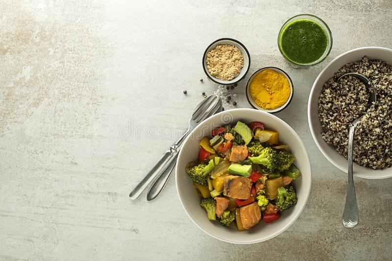 Healthy meal with salmon, vegetable and Quinoa stock photos