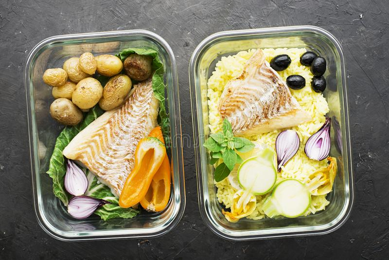 A healthy meal for a snack is a lunch box. Glass containers with fresh steam sea fish, rice with turmeric, fresh royalty free stock photos