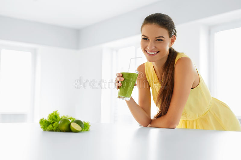 Healthy Meal. Woman Drinking Detox Smoothie. Lifestyle, Food. Dr. Healthy Meal. Happy Beautiful Smiling Woman Drinking Green Detox Vegetable Smoothie. Healthy stock photos